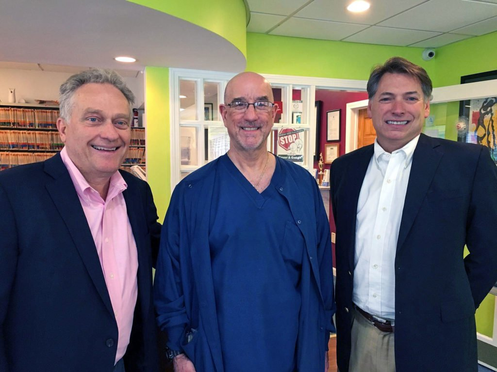 Photo of Drs. Keith Gjebre, Martin Kaplan, and Greg Lane at Dr. Kaplan's office.
